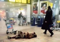 3277430500000578-3505340-Appalling_scenes_An_injured_man_lies_bleeding_on_the_floor_of_Za-a-7_1458696386788