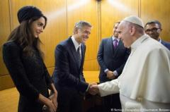 Pope Francis meets U.S. actor Clooney and his wife Amal during a meeting of the Scholas Occurrentes at the Vatican