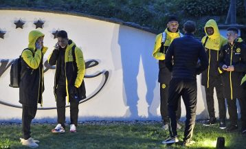 3F2A80CA00000578-4402644-Dortmund_players_stand_outside_the_team_bus_after_it_was_damaged-a-5_1492017360548