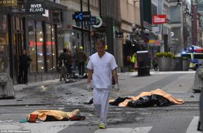 Bodies-lie-covered-in-the-street-in-central-Stockholm-after-the-truck-drove-into-pedestrian