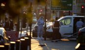 "2017-06-19 05:15:34 Forensic investigators work the scene in the Finsbury Park area of north London after a vehichle hit pedestrians, on June 19, 2017. One man was killed and eight people hospitalised when a van ran into pedestrians near a mosque in north London in an incident that is being investigated by counter-terrorism officers, police said on Monday. The 48-year-old male driver of the van ""was found detained by members of the public at the scene and then arrested by police,"" a police statement said. / AFP PHOTO / Daniel LEAL-OLIVAS"