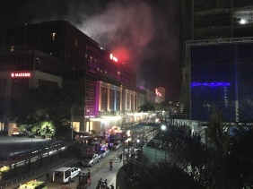Smoke rises from the Resorts World Manila complex early Friday, June 2, 2017 in Manila, Philippines. Gunshots and explosions rang out early Friday at a mall, casino and hotel complex near Manila's international airport in the Philippine capital, sparking a security alarm amid an ongoing Muslim militant siege in the country's south. (AP Photo/Bullit Marquez)