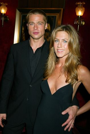 "Brad Pitt and Jennifer Aniston during ""Troy"" New York Premiere - Inside Arrivals at Ziegfeld Theater in New York City, New York, United States. (Photo by Gregory Pace/FilmMagic)"