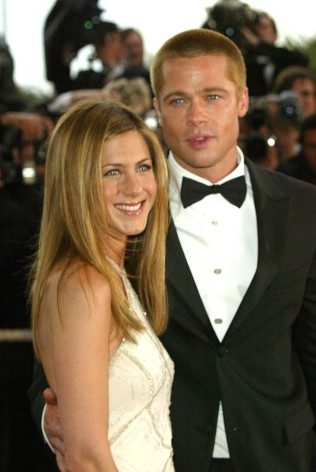 "Jennifer Aniston and Brad Pitt during 2004 Cannes Film Festival - ""Troy"" Premiere at Palais Du Festival in Cannes, France. (Photo by Tony Barson/WireImage)"